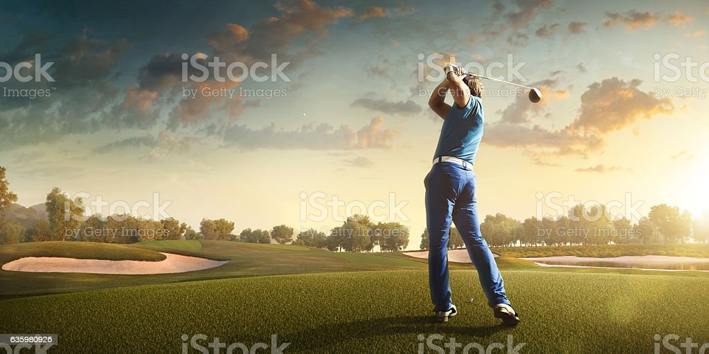 Golf: Man playing golf in a golf course - Photo