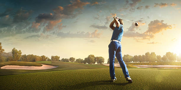 golf: man playing golf in a golf course - golf stock photos and pictures
