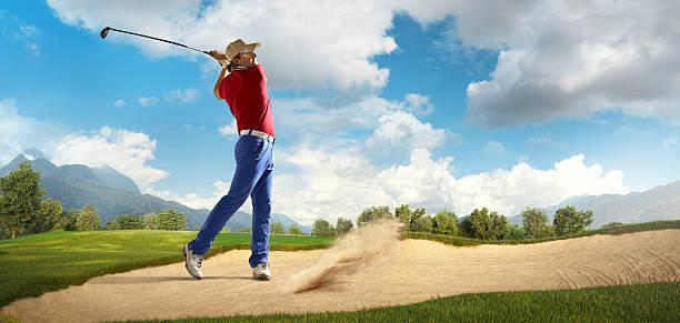 golf: man playing golf in a golf course - schiebermütze stock-fotos und bilder