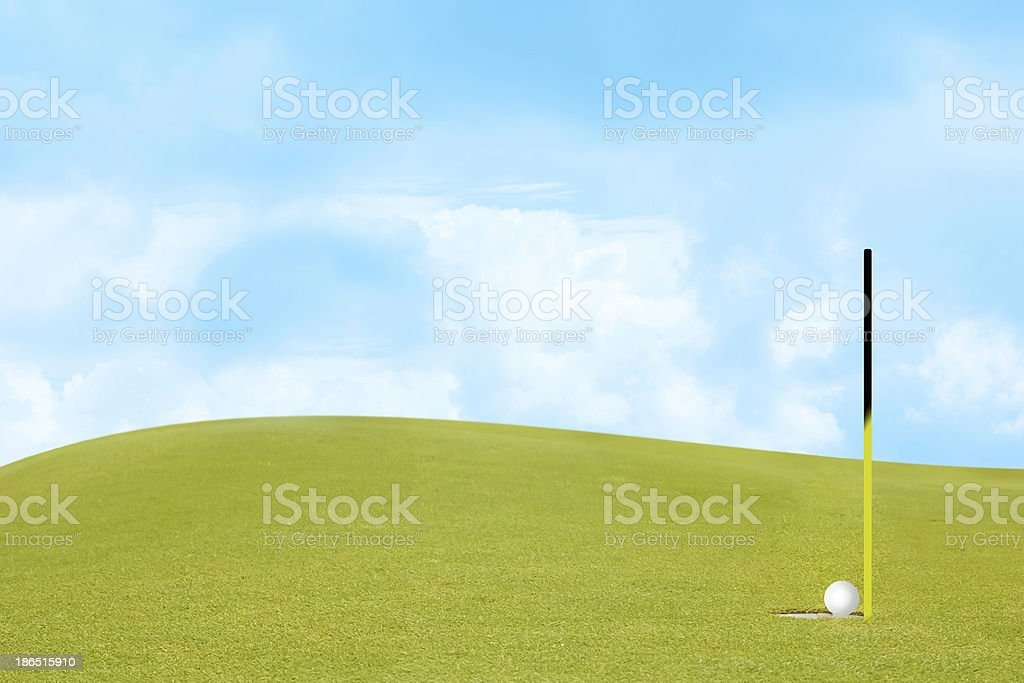 golf on green Include slope and sky. royalty-free stock photo