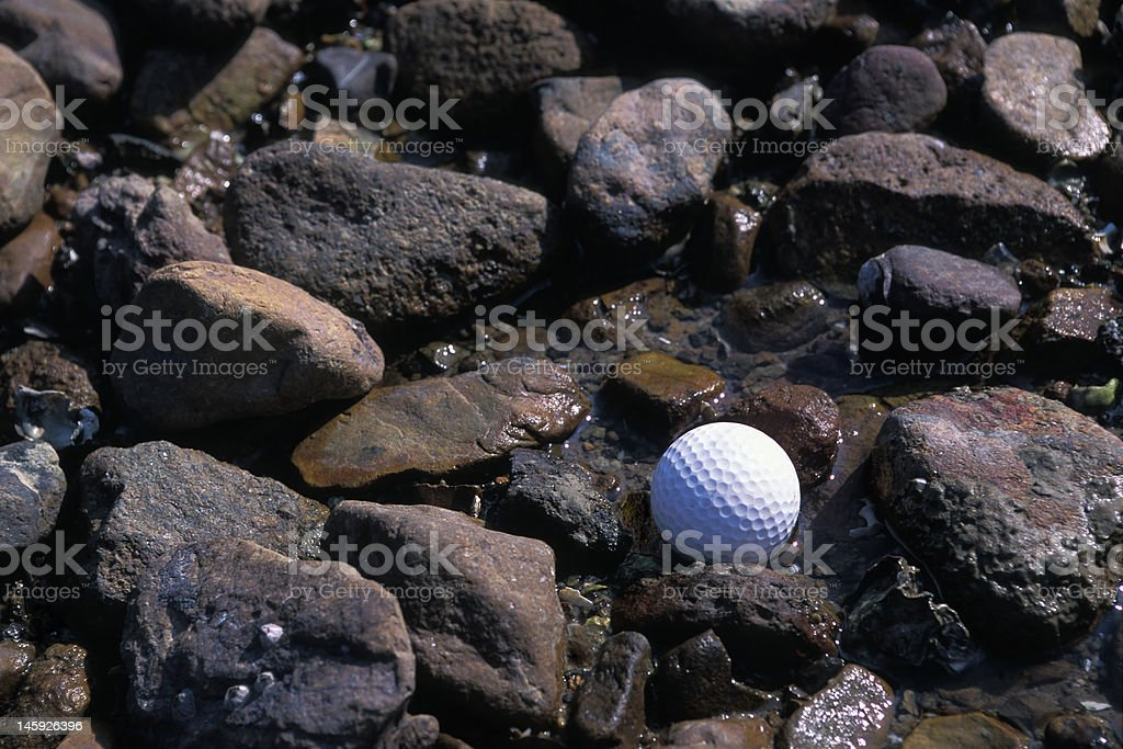 Golf on Rocky Beach stock photo