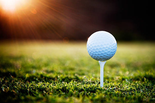 Golf Close up of golf ball on tee golf ball stock pictures, royalty-free photos & images