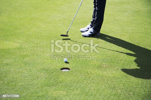 close up of golfer setting up a shot
