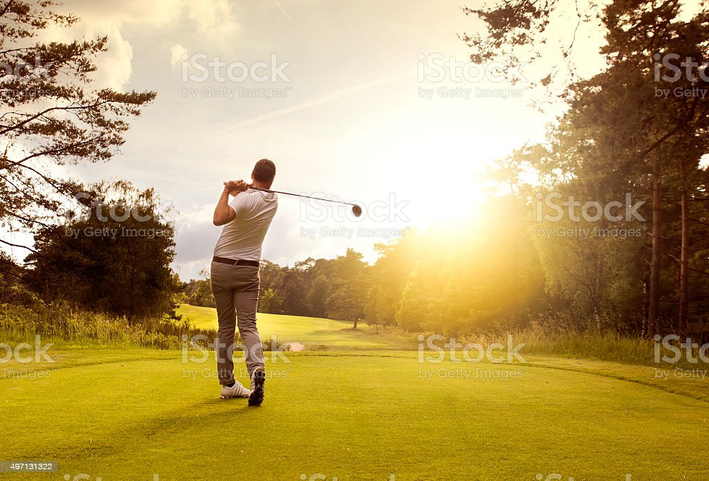 Golf player at teeoff stock photo
