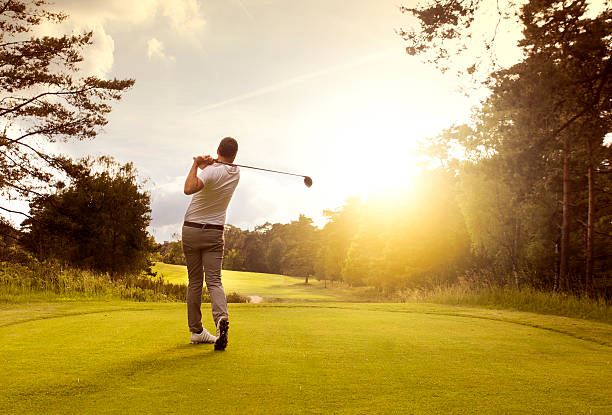 golf player at teeoff - golf stock photos and pictures