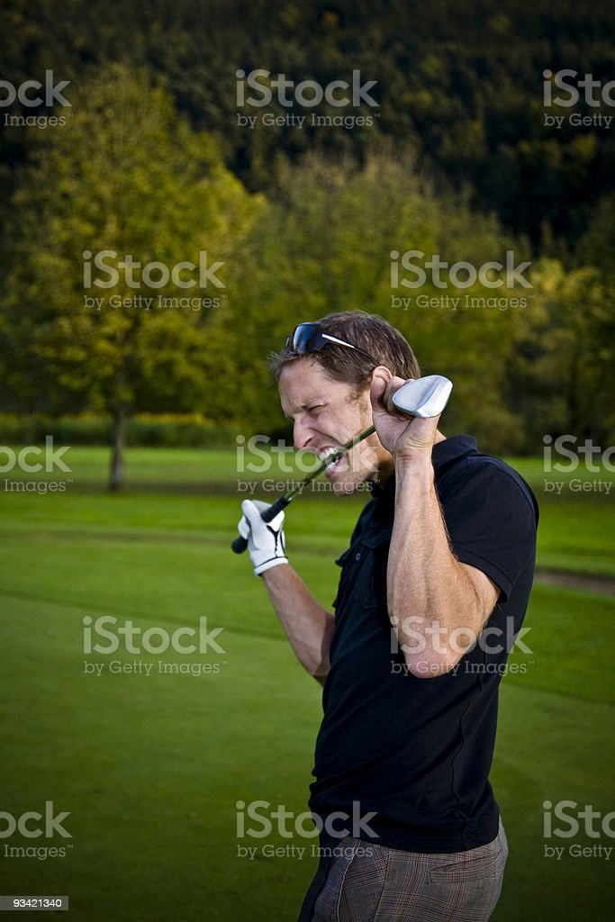 golf player eating club. royalty-free stock photo