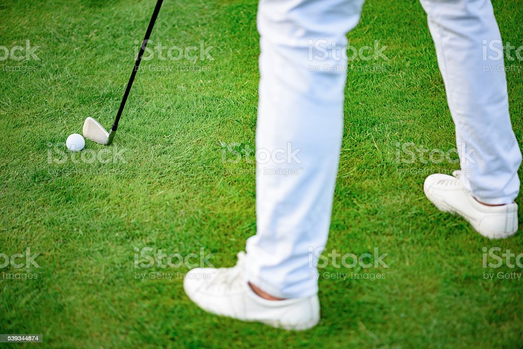 Golf player holding clud stock photo