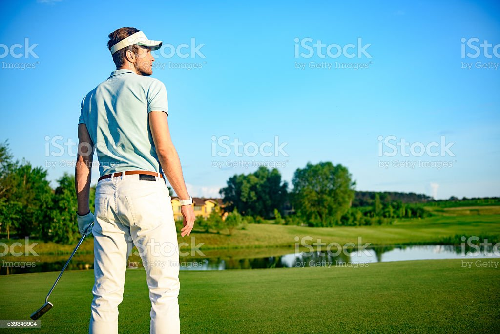 Golf player holding driver stock photo