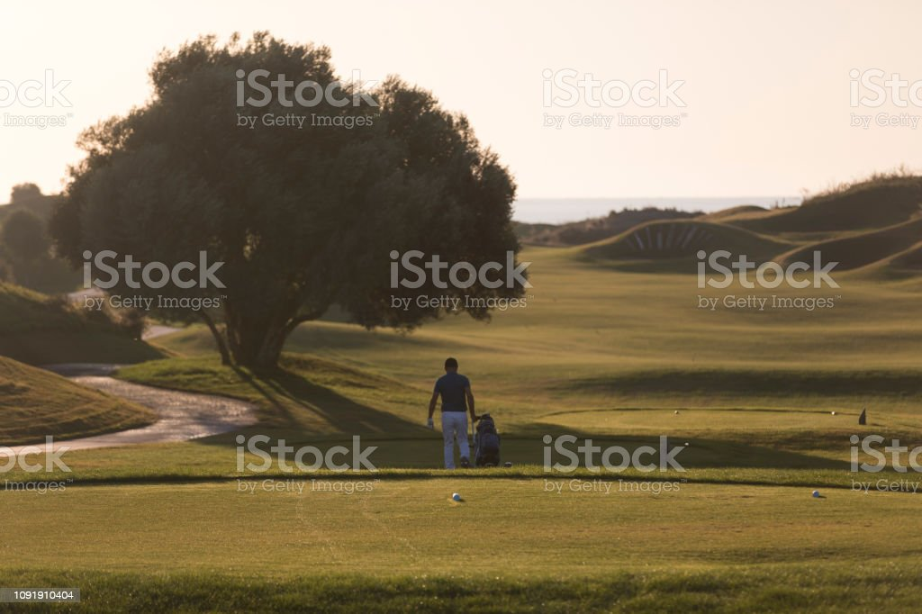 Golf player is turning back after game finished - links golf