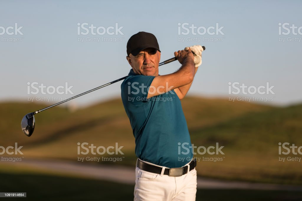 Golf player looking after shoting ball - Links Golf