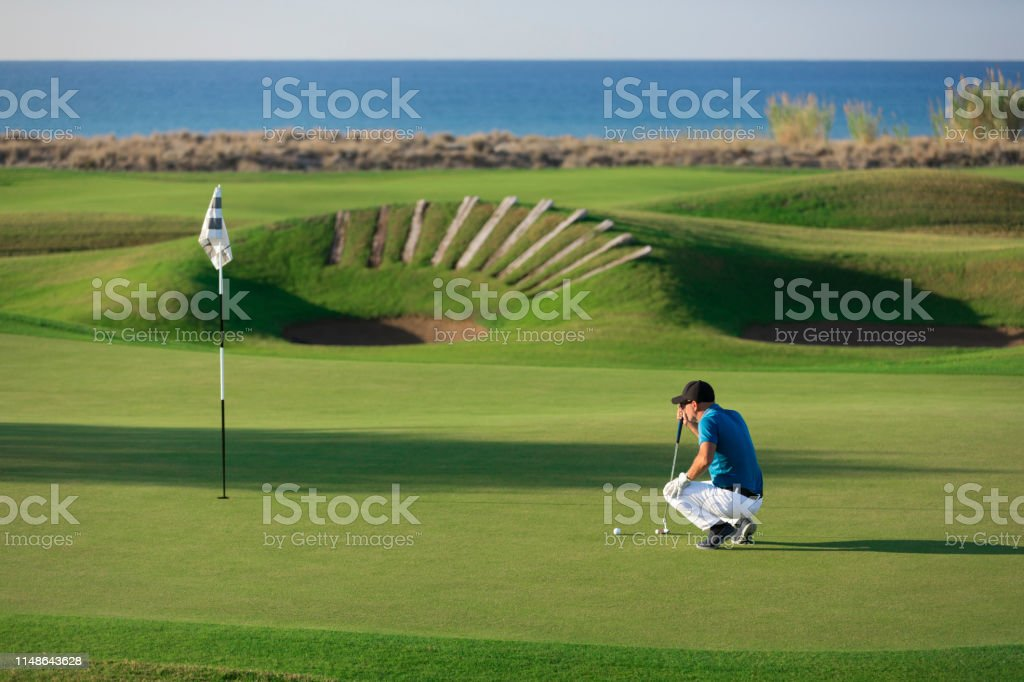 Golf player looking to hole for deciding on the shot - Links Golf