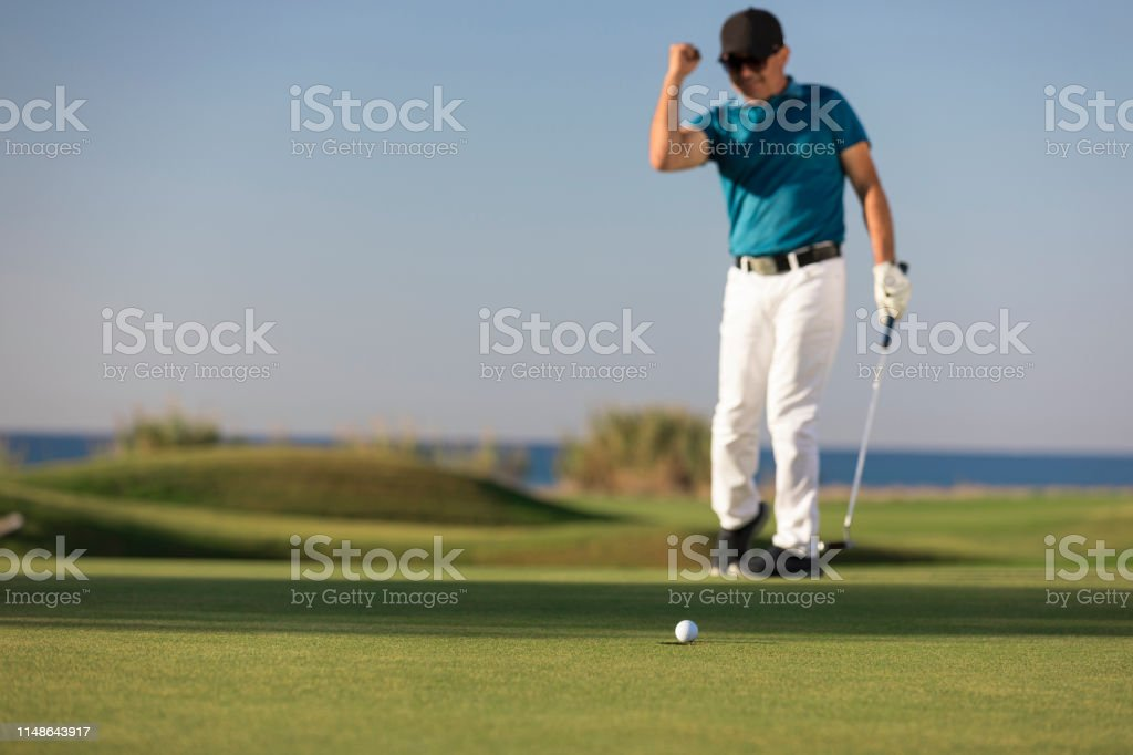 Golf player making a successful stroke - Links Golf