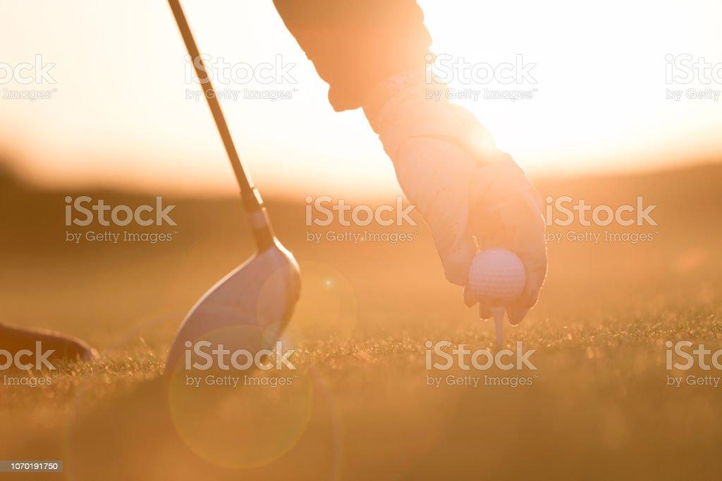 Golf player preparing for shoting - Sunset Time - Links Golf