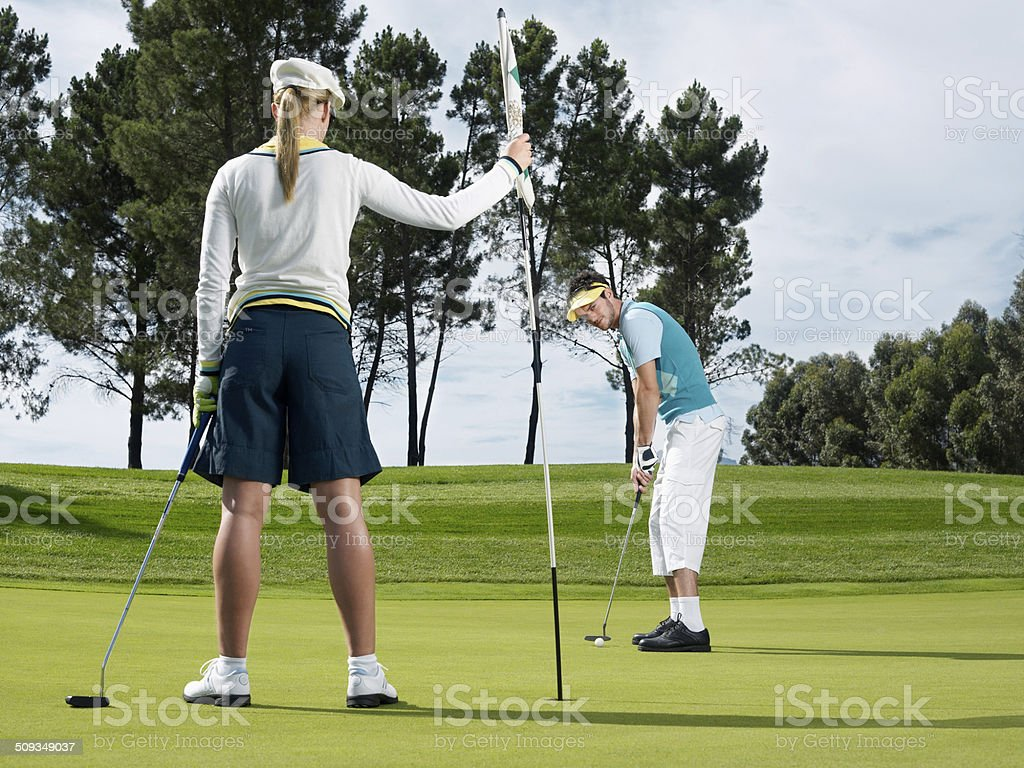 Golf Player Putting On Green stock photo
