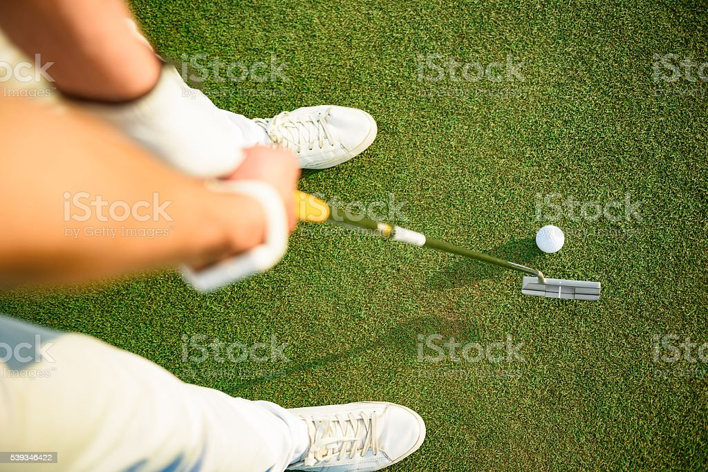 Golf player ready to putting ball stock photo