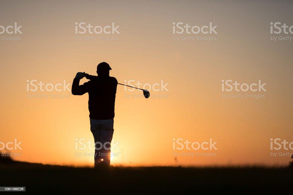 Golf player shoting ball - Links Golf - Sunset Time