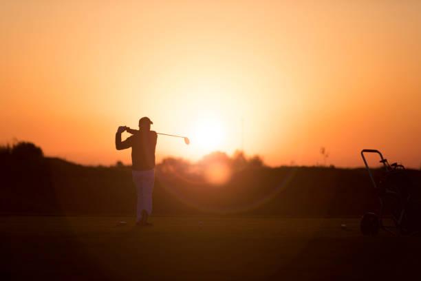 Golf player shoting ball - Sunset Time -  Links Golf stock photo
