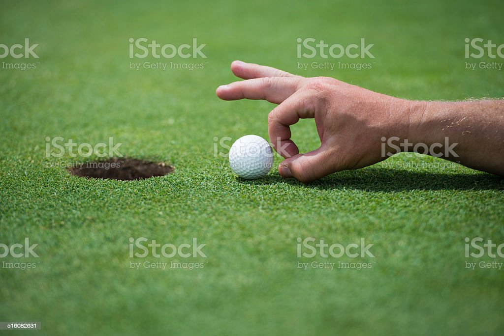Golf player stepping up to his ball.