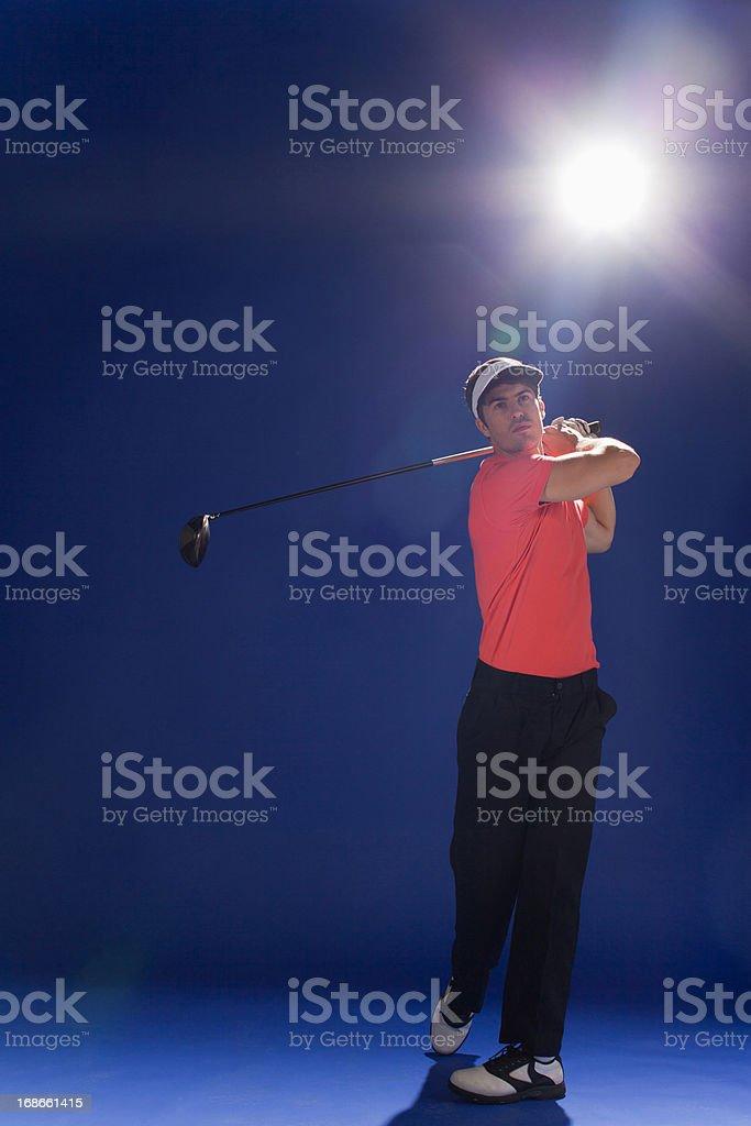Golf player swinging club royalty-free stock photo