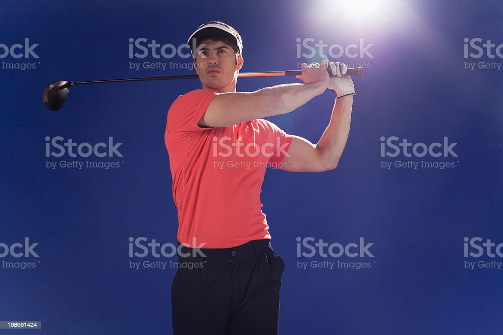 Golf player swinging club royalty-free stock photo