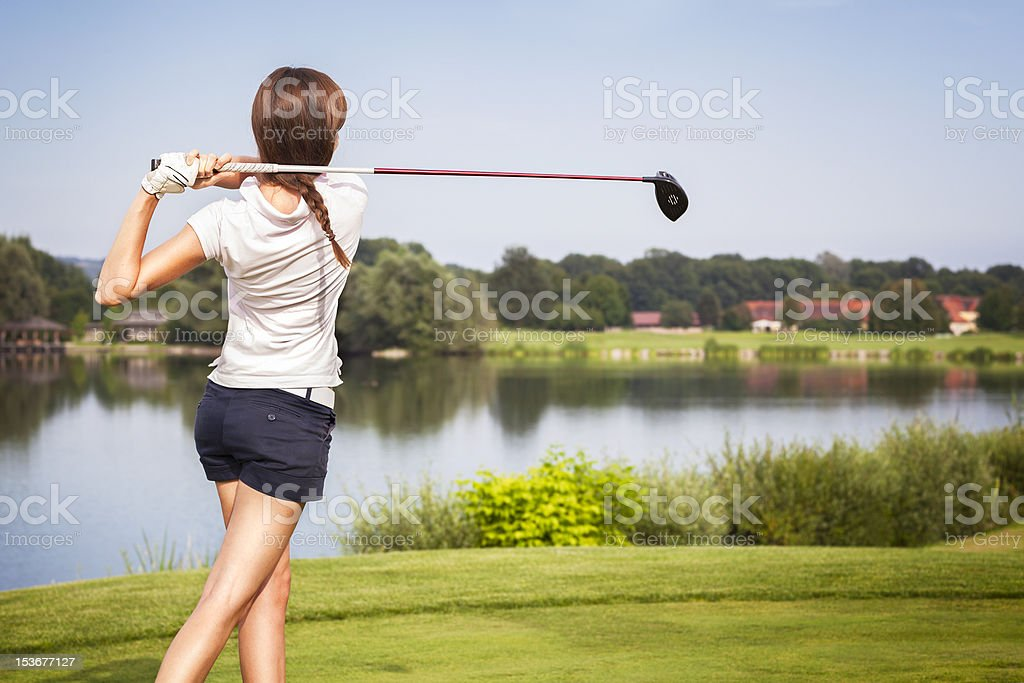 Golf player teeing off. stock photo