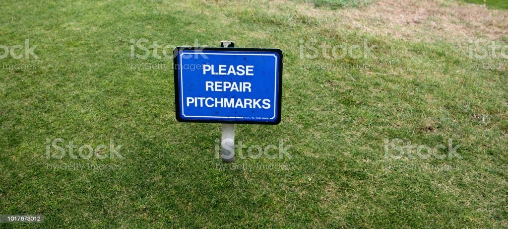 Golf. 'Please Repair the Pitchmarks'. On the Course at Royal St Georges, Kent, England stock photo