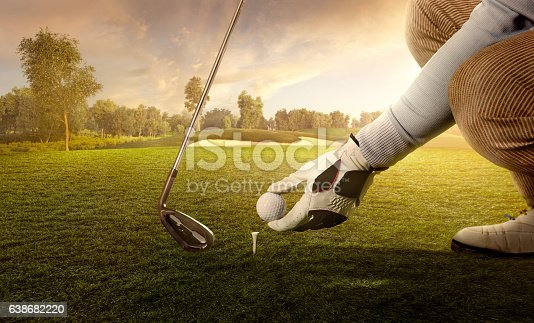 Professional golfer is preparing for a great strike.