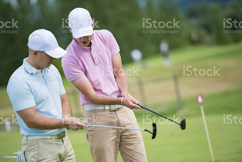 Golf Pro Teaching Male Golfer royalty-free stock photo