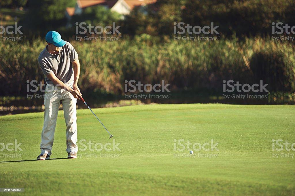golf putt green stock photo