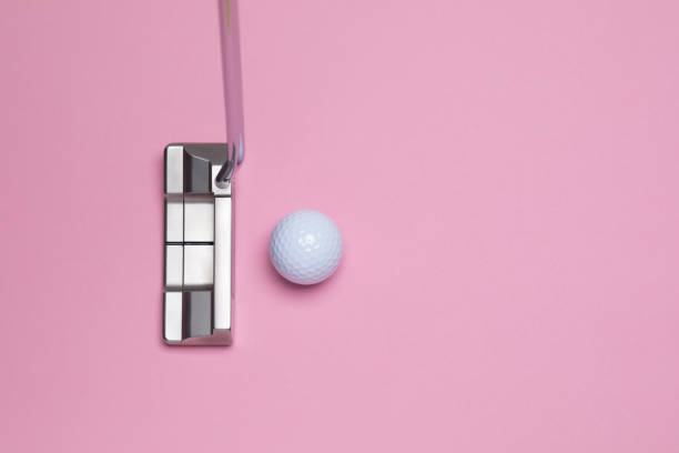 Golf putter and golfball stock photo