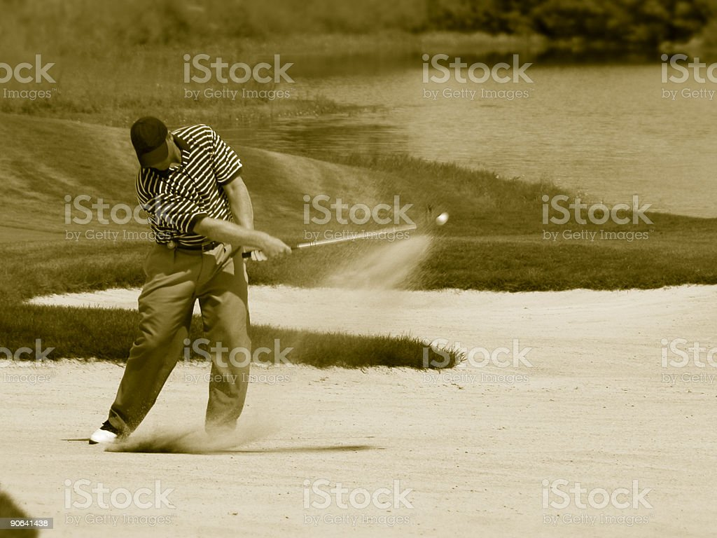 Golf sand shot ball in motion royalty-free stock photo