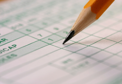Macro shot of a golf score sheet and a pencil.  Shallow focus on pencil lead.