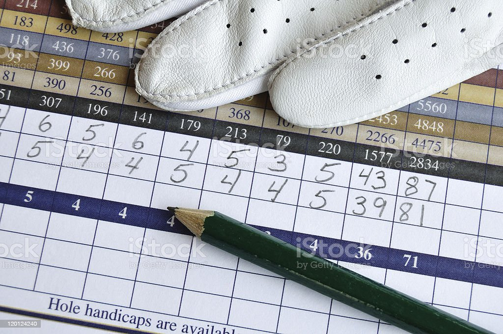 Golf Score Card with Glove and Green Pencil stock photo