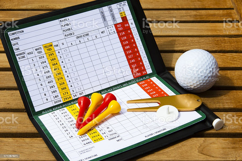 Golf scorecard with golfing accessories stock photo
