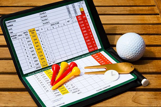 Golf scorecard with golfing accessories stock photo
