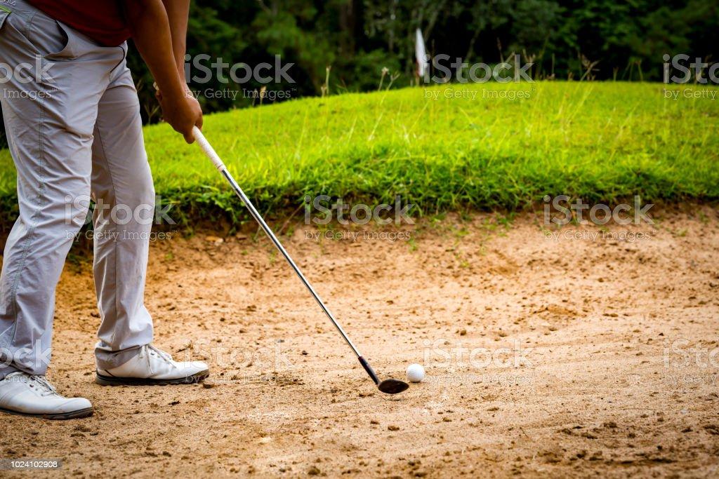 Golf sport concept, Golfer hitting golf ball on bunker of sand in...
