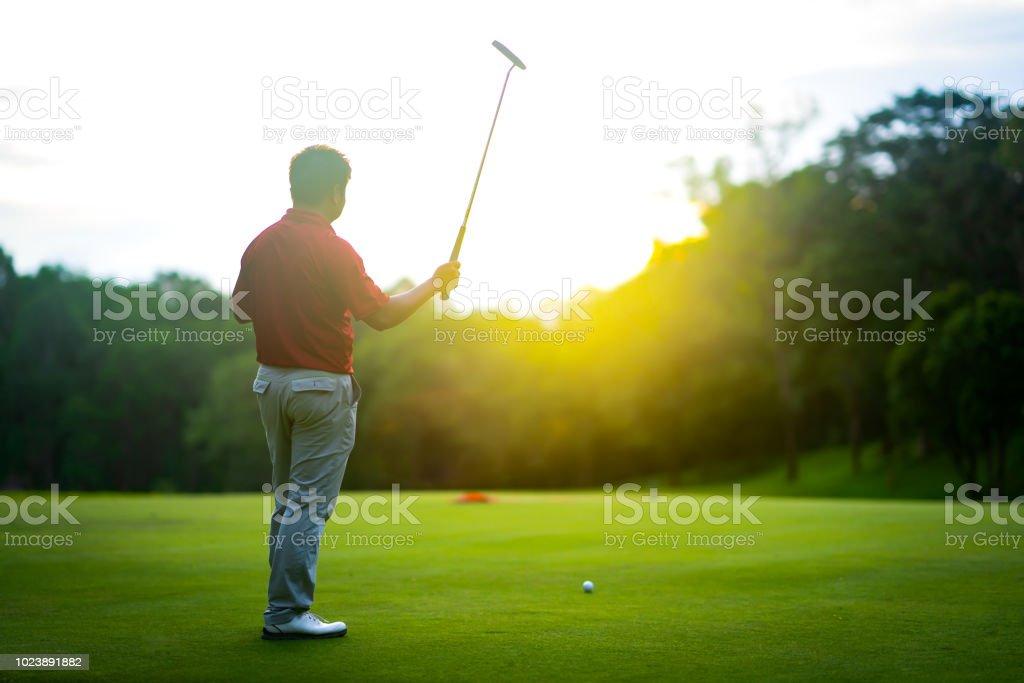Golf sport concept, golfer raise golf club up show the winner of...