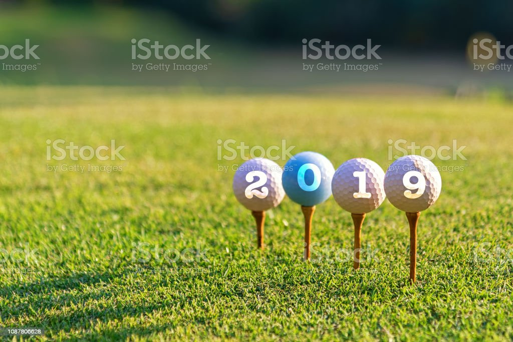 Golf sport conceptual. Happy new year 2019. Golf ball on the tee....