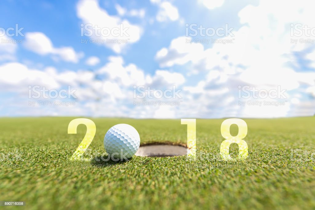 Golf sport conceptual image.Happy new year 2018. Golf ball on the...