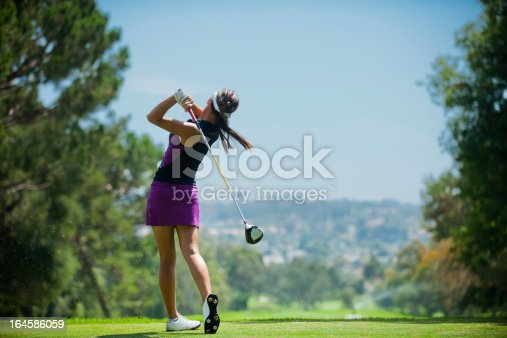 A golfer at the end of his golf swing.