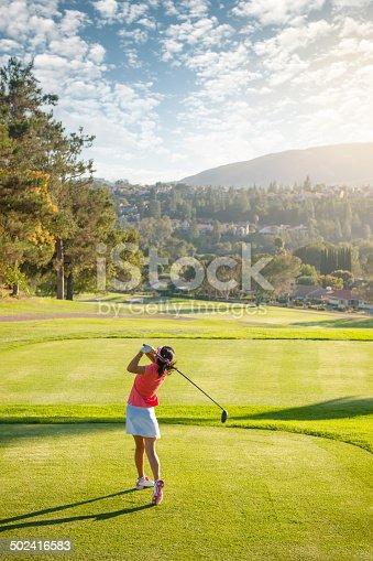 A women swinging at the golf ball on a beautiful course. http://blog.michaelsvoboda.com/GolfBanner.jpg