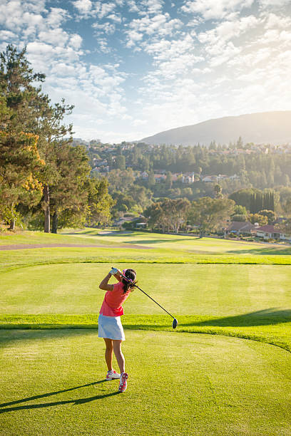 golf swing - female golfer stock photos and pictures