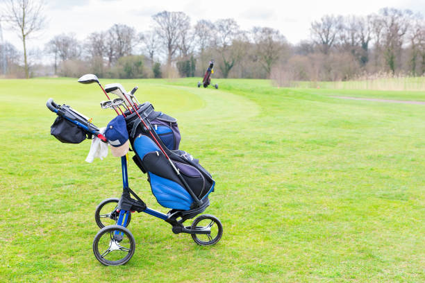 Golf trolley parked on dutch golf course stock photo