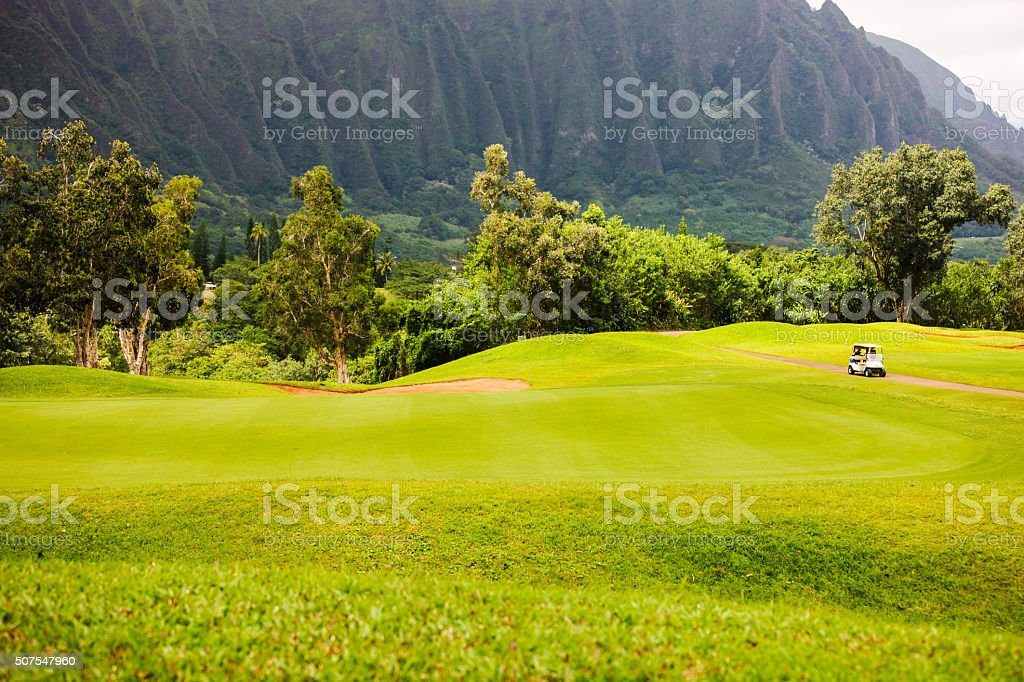 Golf under Ko'olau Mountains stock photo