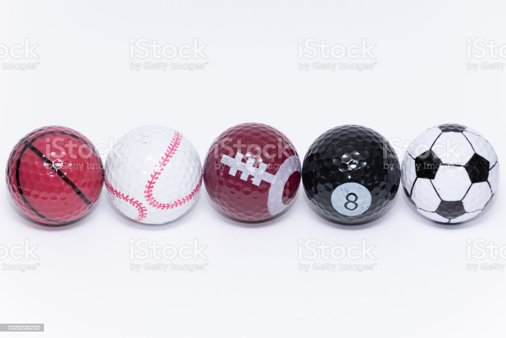Golfball painted like a ball of many different kinds of sports stock photo