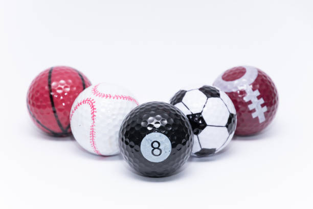 Golfball painted like a ball of many different sports golf balls stock photo