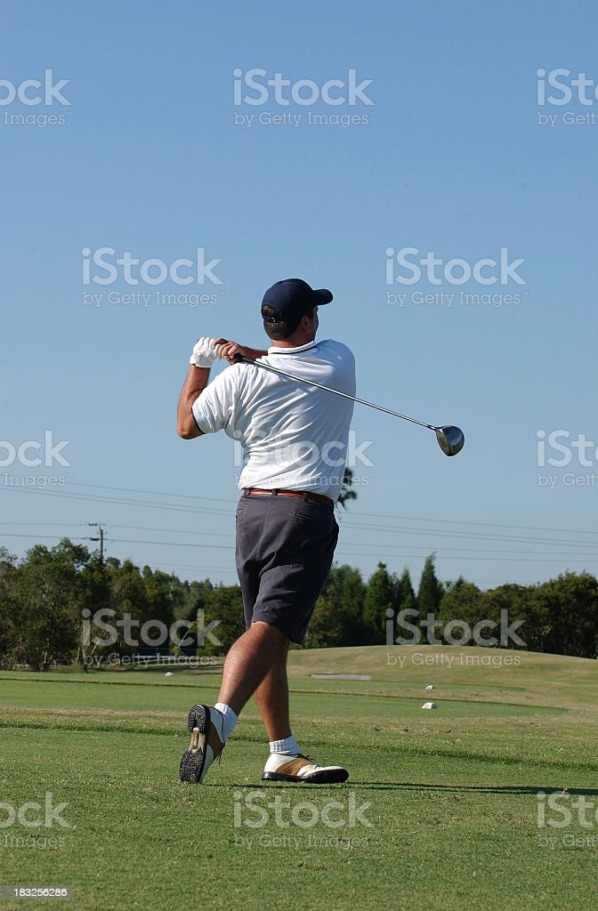 Golfer after swing royalty-free stock photo