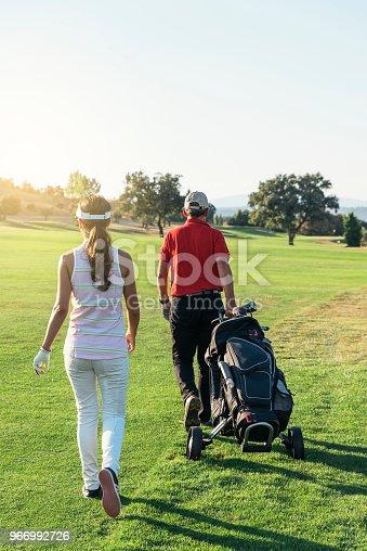Golfer and Caddie playing golf. Golf Concept.