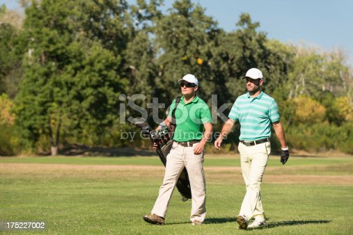Golfer and caddy on golf course