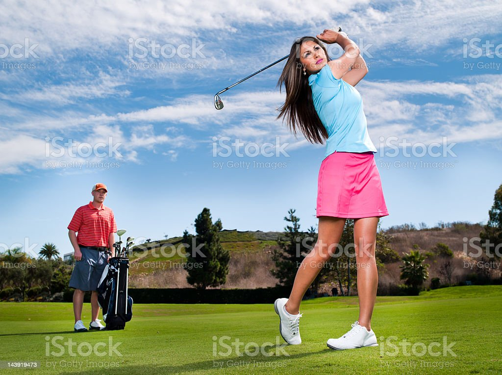 Golfer and Caddy royalty-free stock photo